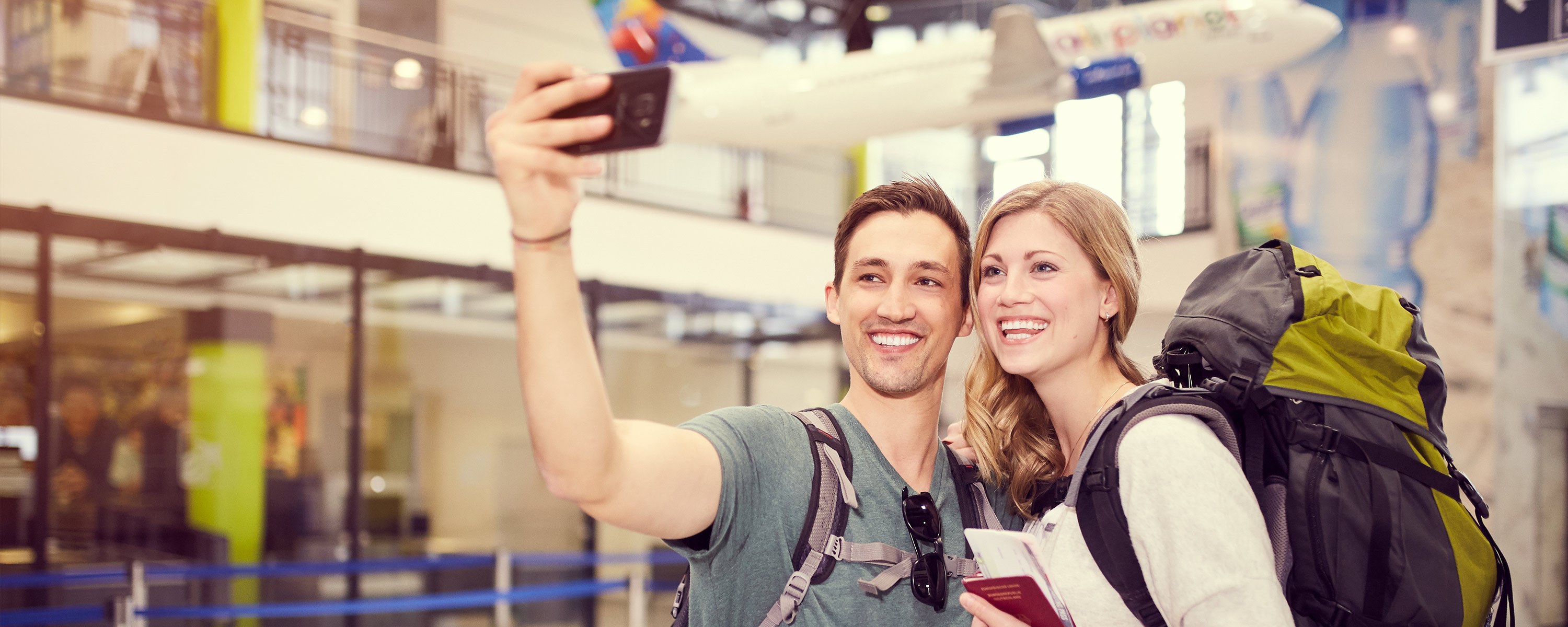 couple making a selfie at security check