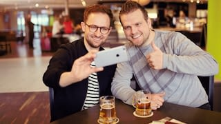 Two men making a selfie while drinking bear
