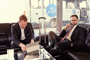 two business traveler waiting in the GAT