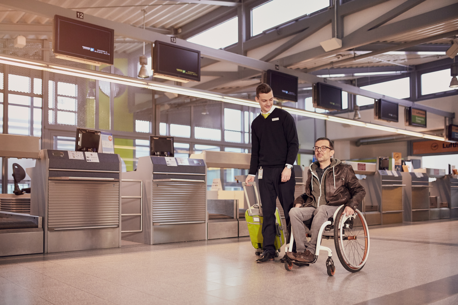 wheelchair user accompanied by staff
