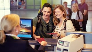 Young backpacker couple at check-in