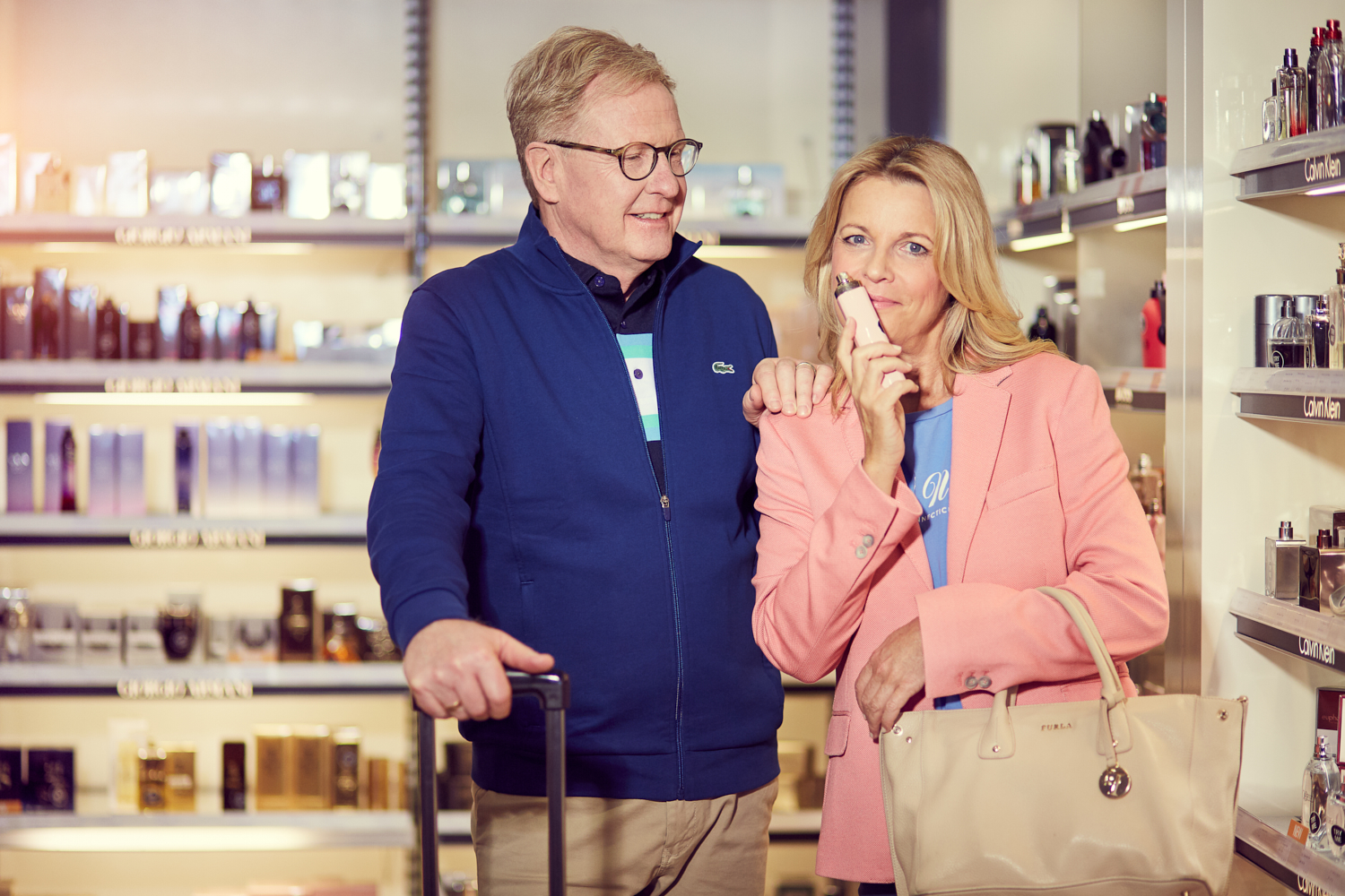 couple with parfum in duty free shop