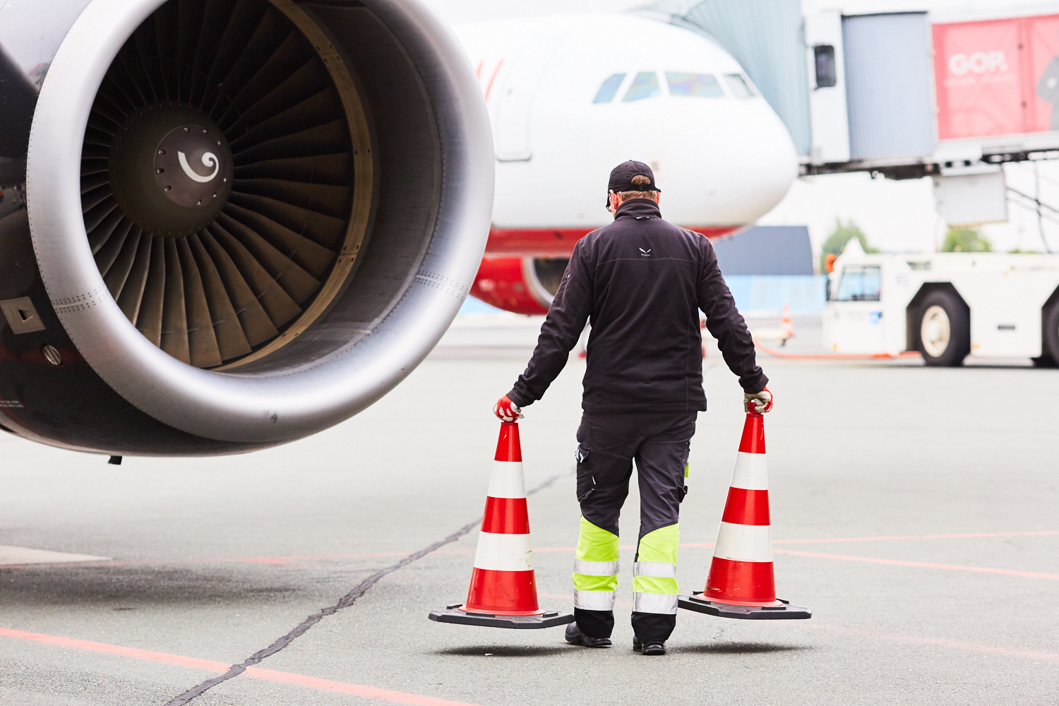 airport staff working on a plane
