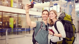 young couple taking a selfie at the terminal